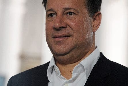 Panamanian presidential candidate for the Panamenista Party (PP), Juan Carlos Varela, smiles in Panama City, on May 3, 2014, on the eve of presidential elections.  AFP PHOTO/Orlando SIERRA.