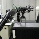 A pitching robot throws a ball made of polystyrene against a batting robot, right, during a demonstration at University of Tokyo in Tokyo, Japan, Friday, July 24, 2009. The both robots have been developed by Information Science Technology Prof. Masatoshi Ishikawa. The pitching robot can throw 40 kph (25mph) strike balls at one-meter (3 feet 3 inches) by 0.8-meter (2 feet 6 inches) strike zone set at 3.5-meter (11 feet 5 inches) away with almost 100 percent accuracy and the batting robot can hit them with more than 90 percent accuracy if hey were thrown in to the strike zone. (AP Photo/Itsuo Inouye)