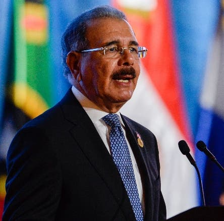 Dominican President Danilo Medina delivers a speech during the opening ceremony of the Fifth Summit of the Community of Latin American and Caribbean States (CELAC) in Bavaro, Dominican Republic, on January 24, 2017. Latin American and Caribbean leaders hold a summit of the 33-nation CELAC, set to discuss trade, migration and drug policies. / AFP / Federico PARRA