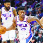 Philadelphia 76ers guard Jimmy Butler (23) drives against the Detroit Pistons in the second half of an NBA basketball game in Detroit, Friday, Dec. 7, 2018. (AP Photo/Paul Sancya)