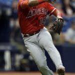 FILE - In this May 25, 2017, file photo, Los Angeles Angels third baseman Luis Valbuena throws out Tampa Bay Rays' Kevin Kiermaier on a sacrifice bunt during the fifth inning of a baseball game in St. Petersburg, Fla. Major League Baseball players Luis Valbuena and Jose Castillo have been killed in a car crash in Venezuela.MLB tweeted late Thursday, Dec. 6, 2018, the 33-year-old Valbuena and 37-year-old Castillo died. Both were playing for Cardenales de Lara in the Venezuelan league. (AP Photo/Chris O'Meara, File)