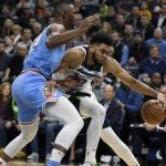 Sacramento Kings forward Harry Giles (20) guards against Minnesota Timberwolves center Karl-Anthony Towns (32) during the second quarter of an NBA basketball game on Monday, Dec. 17, 2018, in Minneapolis. (AP Photo/Hannah Foslien)