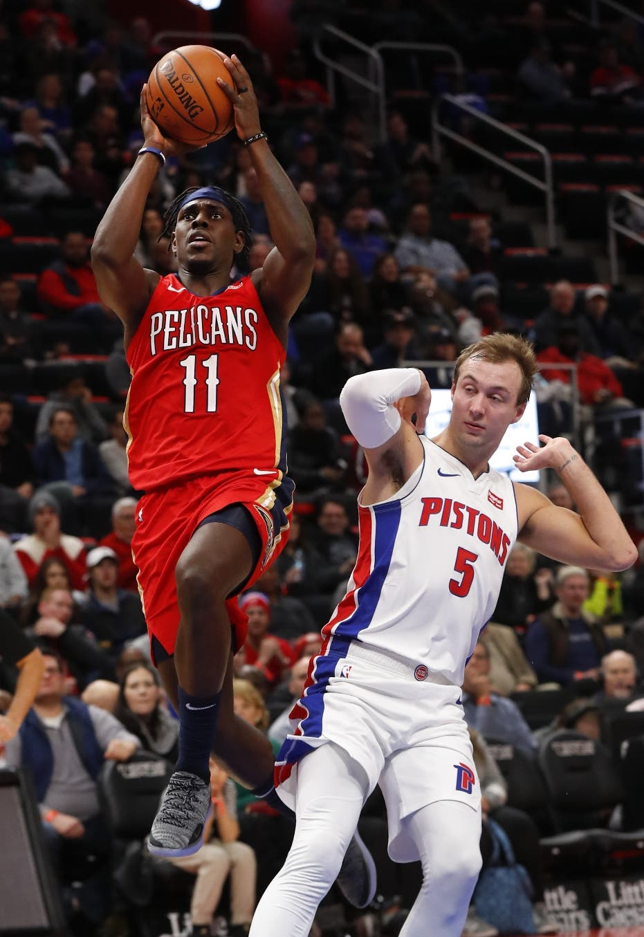 New Orleans Pelicans guard Jrue Holiday (11) drives against Detroit Pistons guard Luke Kennard (5) in the second half of an NBA basketball game in Detroit, Sunday, Dec. 9, 2018. (AP Photo/Paul Sancya)