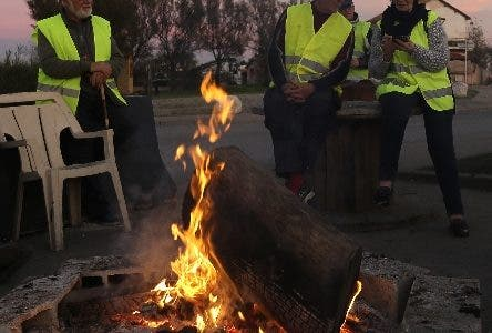 A group of demonstrators wearing their yellow vest occupy a traffic circle, Wednesday, Dec. 5, 2018, outside La Mede oil refinery, near Martigues, southeastern France. Trade unions and farmers pledged Wednesday to join nationwide protests against President Emmanuel Macron, as concessions by the government failed to stem the momentum of the most violent demonstrations France has seen in decades.  (AP Photo/Claude Paris)