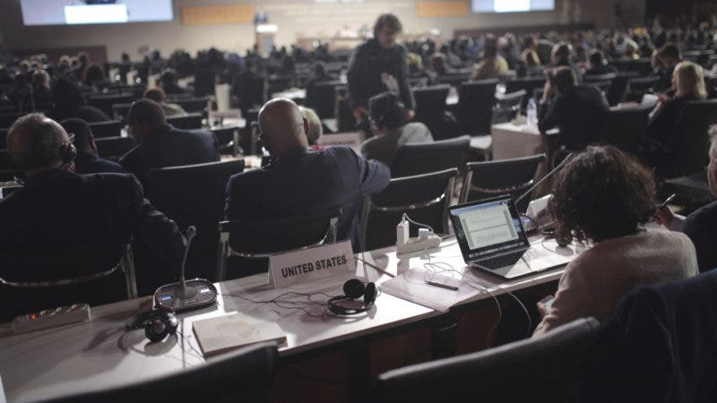 The empty seat of the US representative is seen during the opening session of a UN Migration Conference in Marrakech, Morocco, Monday, Dec.10, 2018. Top U.N. officials and government leaders from about 150 countries are uniting around an agreement on migration, while finding themselves on the defensive about the non-binding deal amid criticism and a walkout from the United States and some other countries. (AP Photo/Mosa'ab Elshamy)