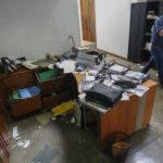 Confidencial director Carlos Fernando Chamorro, the son of former President Violeta Barrios de Chamorro, walks through his ransacked offices while talking on his cellphone in Managua, Nicaragua, Friday, Dec. 14, 2018. Nicaraguan police raided the offices of five nongovernmental organizations and Confidencial, an independent media outlet, on Thursday, alleging that they participated in seeking the government's overthrow. (AP Photo/Alfredo Zuniga)
