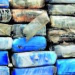 El pais.Ocupan 198 paquetes de presunta cocaína, armas de alto calibre y equipos de buceo,en foto el Corenel vocero de la Policia Duran Majia.Hoy/Pablo Matos  11-12-2018