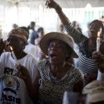 In this Dec. 13, 2018 photo, Miliana Louis cries during a memorial for the victims of a massacre in the La Saline slum of Port-au-Prince, Haiti. Louis said her 22-year-old son James was killed with a machete in the mass killing on Nov. 13, and his body fed to pigs. (AP Photo/Dieu Nalio Chery)