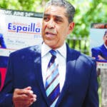 Congressional candidate Adriano Espaillat speaks with reporters in New York, Monday, June 23, 2014. With Primary Day just a day away, Espaillat, a Dominican-born legislator running in an increasingly Hispanic district,  is the top challenger trying to unseat Rep. Charles Rangle, who is seeking a 23rd term representing the district.  (AP Photo/Seth Wenig)