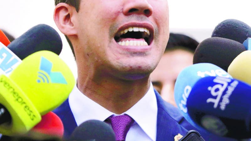 Venezuelan opposition leader Juan Guaido, who has declared himself interim president, speaks to the press after a meeting with coalition of opposition parties, and other civic groups in Caracas, Venezuela, Monday, March 18, 2019. After Guaido declared himself interim president in late Feb., Venezuelan President Nicolas Maduro has remained in power despite heavy pressure from the United States and other countries arrayed against him, managing to retain the loyalty of most of his military leaders. (AP Photo/Natacha Pisarenko)