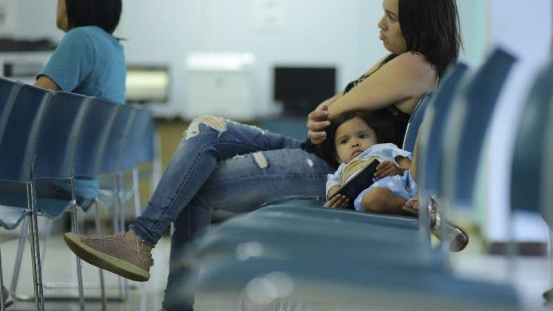 Three-year-old daughter Ailianie Hernandez waits with her mother Julianna Ageljo to apply for the nutritional assistance program at the Department of Family Affairs, in Bayamon, Puerto Rico, Friday, March 29, 2019. Hundreds of thousands of Puerto Ricans are feeling the sting of what the territorial government says are insufficient federal funds to help the island recover from the Category 4 storm amid a 12-year recession. (AP Photo/Carlos Giusti)