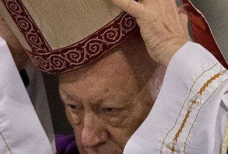 Former Archbishop of Santiago, Cardinal Ricardo Ezzati, removes his miter during Mass at the Cathedral of Santiago, Chile, Sunday, March 24, 2019. Pope Francis on Saturday replaced Ezzati as archbishop of Santiago, Chile, after he was placed under criminal investigation in the country's spiraling church sex abuse and cover-up scandal. (AP Photo/Esteban Felix)