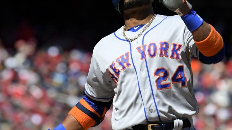 New York Mets' Robinson Cano celebrates his home run during the first inning of a baseball game against the Washington Nationals, Thursday, March 28, 2019, in Washington. (AP Photo/Nick Wass)