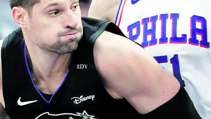 Orlando Magic's Nikola Vucevic (9) makes a move to the basket against Philadelphia 76ers' Boban Marjanovic, right, during the first half of an NBA basketball game, Monday, March 25, 2019, in Orlando, Fla. (AP Photo/John Raoux)