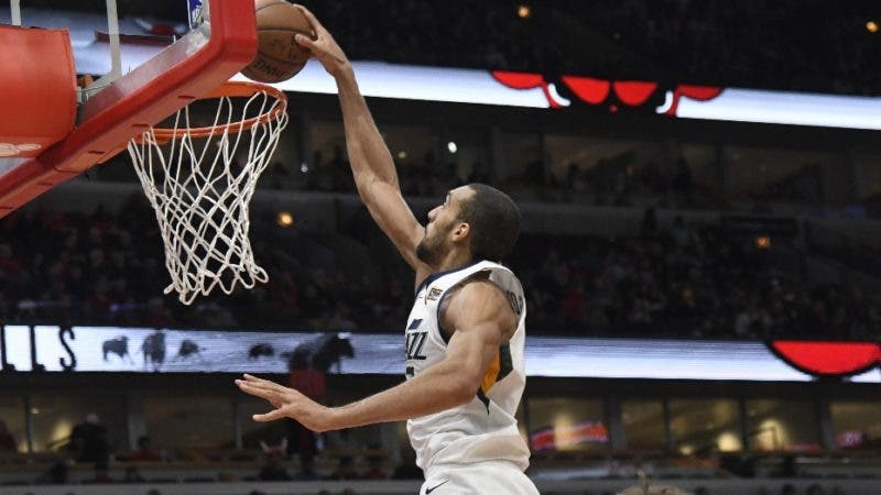 Utah Jazz center Rudy Gobert dunks against the Chicago Bulls during the second half of an NBA basketball game Saturday, March 23, 2019, in Chicago. The Jazz won 114-83. (AP Photo/David Banks)