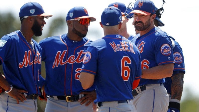 New York Mets manager Mickey Callaway, right, talks with his infielders as he makes a pitching change fifth inning of a spring training baseball game against the Baltimore Orioles, Monday, March 25, 2019, in Sarasota, Fla. (AP Photo/John Bazemore)