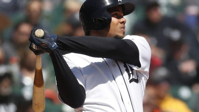 Detroit Tigers' Jeimer Candelario hits a two-run home run against the Baltimore Orioles in the fourth inning of a baseball game in Detroit, Thursday, April 19, 2018. (AP Photo/Paul Sancya)