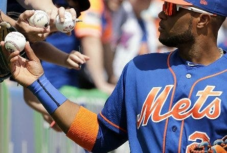 New York Mets second baseman Robinson Cano (24) gives autographs before an exhibition spring training baseball game against the Washington Nationals, Sunday, March 24, 2019, in Port St. Lucie, Fla. (AP Photo/Brynn Anderson)