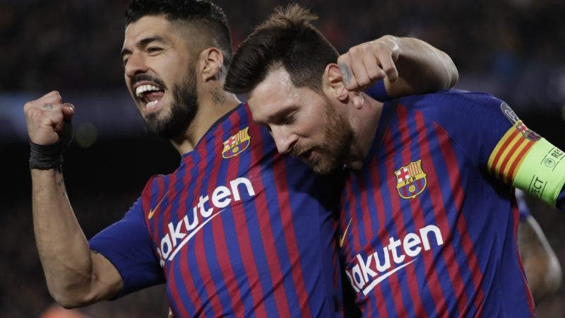 Barcelona's Lionel Messi, right and Barcelona's Luis Suarez celebrate after Messi scored his side's third goal during the Champions League round of 16, 2nd leg, soccer match between FC Barcelona and Olympique Lyon at the Camp Nou stadium in Barcelona, Spain, Wednesday, March 13, 2019. (AP Photo/Emilio Morenatti)
