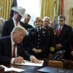 President Donald Trump signs the first veto of his presidency in the Oval Office of the White House, Friday, March 15, 2019, in Washington. Trump issued the veto, overruling Congress to protect his emergency declaration for border wall funding. (AP Photo/Evan Vucci)