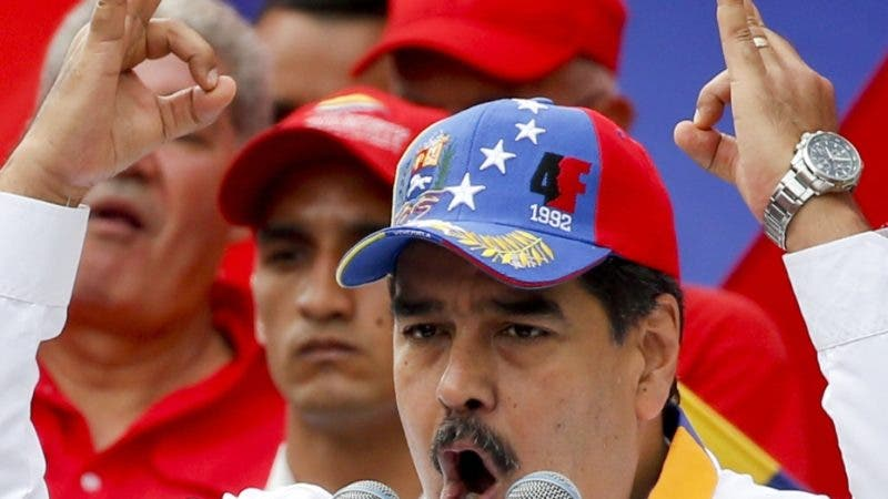 Venezuela's President Nicolas Maduro speaks during an anti-imperialist rally for peace, in Caracas, Venezuela, Saturday, March 23, 2019. The U.S. withdrew all embassy personnel from Caracas due to safety concerns after Maduro severed ties with the U.S. over its support for opposition leader Juan Guaido. (AP Photo/Natacha Pisarenko)