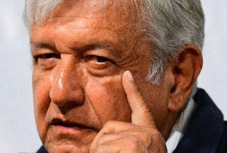 """Mexico's presidential candidate for the MORENA party, Andres Manuel Lopez Obrador, speaks during a conference on """"Peace and Justice in Mexico"""" in Mexico City, on May 08, 2018. / AFP / RONALDO SCHEMIDT"""