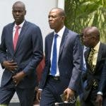 Haiti's President Jovenel Moise, from left, Special Advisor Jose Daniel Joseph and Communications Minister Jean-Michel Lapin, who was named interim prime minister, arrive for Lapin's presentation ceremony, in Port-au-Prince, Haiti, Thursday, March 21, 2019. ( AP Photo/Dieu Nalio Chery)