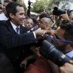 Venezuela's self-proclaimed interim president Juan Guaido, center, arrives for a rally in Caracas, Venezuela, Thursday, March 28, 2019. The Venezuelan government on Thursday said it has barred Guaido from holding public office for 15 years, though the National Assembly leader brushed off the measure and said it would not derail his campaign to oust President Nicolas Maduro. (AP Photo/Natacha Pisarenko)