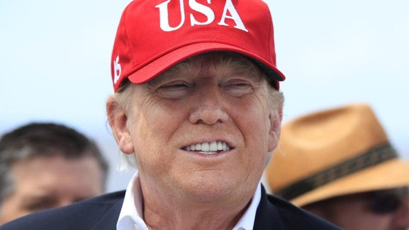 President Donald Trump speaks to reporters during a visit to Lake Okeechobee and Herbert Hoover Dike at Canal Point, Fla., Friday, March 29, 2019. (AP Photo/Manuel Balce Ceneta)