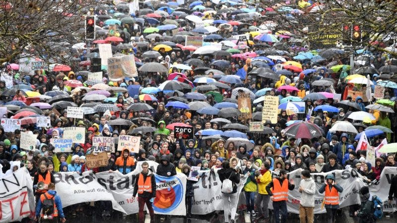 "Thousands of students demonstrate during a ""Climate strike"" protest in Zurich, Switzerland, Friday, March 15, 2019. Students from several countries worldwide plan to skip class Friday in protest over their governments' failure to act against global warming.(Walter Bieri/Keystone via AP)"