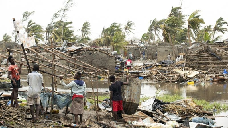 In this photo taken on Friday, March 15, 2019 and provided by the International Red Cross, people try to salvage what is left of their homes after Tropical Cyclone Idai, in Beira, Mozambique. Mozambique's President Filipe Nyusi says that more than 1,000 may have by killed by Cyclone Idai, which many say is the worst in more than 20 years. Speaking to state Radio Mozambique, Nyusi said Monday, March 18 that although the official death count is currently 84, he believes the toll will be more than 1,000. (Denis Onyodi/IFRC via AP)