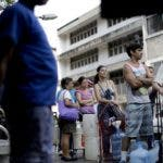 People line up to get water from a truck in Caracas, Venezuela, Wednesday, March 27, 2019. After days of intermittent electricity supply in Venezuela, which affects the water supply, the people in the capital city have started to collect water from waterfalls and wells and carry it to their homes. (AP Photo/Natacha Pisarenko)