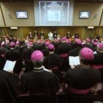 "Pope Benedict XVI (C-back) opens a session of a synod of Catholic bishops on the theme of ""The Word of God in the Life and Mission of the Church"" on October 6, 2008 at the Vatican.  Of the 253 archbishops, bishops and cardinals summoned to the three-week long synod, 51 are from Africa, 62 from the Americas, 41 from Asia, 90 from Europe and nine from the Pacific with for the first time representatives and prelates from other religions.  AFP PHOTO / FILIPPO MONTEFORTE"