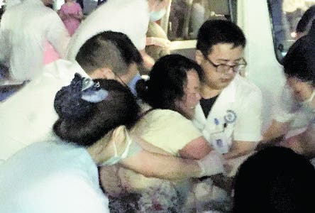 In this photo released by Xinhua News Agency, medical staff tend to a wounded at a local hospital in the aftermath of an earthquake in Changning County of Yibin City, southwest China's Sichuan Province, early Tuesday, June 18, 2019. The strong earthquake that hit Sichuan province in southern China late Monday night killed and injured some, officials and news reports said. (Wan Min/Xinhua via AP)