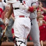 Los Angeles Angels' Albert Pujols, right, hugs former teammate St. Louis Cardinals catcher Yadier Molina, left, before batting during the first inning a baseball game Friday, June 21, 2019, in St. Louis. (AP Photo/L.G. Patterson)