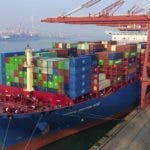In this Friday, Jan. 11, 2019, photo, containers are loaded onto a cargo ship at a port in Qingdao in east China's Shandong province. China's trade growth slowed in 2018 as a tariff battle with Washington heated up and global consumer demand weakened. Exports rose 7.1 percent, customs data showed Monday, Jan. 14, 2019, down from the 7.9 percent reported earlier for 2017. Import growth declined to 12.9 percent from the previous year's 15.9 percent. (Chinatopix via AP)