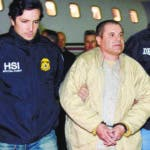 "FILE - In this Jan. 19, 2017, file photo provided by U.S. law enforcement, authorities escort Joaquin ""El Chapo"" Guzman, center, from a plane to a waiting caravan of SUVs at Long Island MacArthur Airport, in Ronkonkoma, N.Y. Guzman, who was convicted in February 2019 on multiple conspiracy counts in an epic drug-trafficking case, will be sentenced in a New York courtroom on Wednesday, July 17, 2019. (U.S. law enforcement via AP, File)"