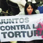 "The opposition parliamentarian Delsa Solorzano holds a banner that in Spanish says ""Together against torture"" during a session of the National Assembly in Caracas , Venezuela, Tuesday, July 16, 2019. Venezuelan authorities have detained two members of opposition leader Juan Guaidó's security team, keeping pressure on their U.S.-backed adversary even as the two sides hold talks aimed at finding a solution to the country's political standoff. (AP Photo/Leonardo Fernandez)"