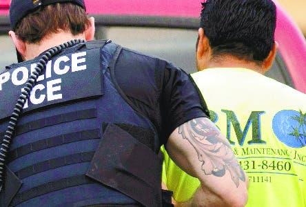 FILE - In this July 8, 2019 file photo, U.S. Immigration and Customs Enforcement (ICE) officers detain a man during an operation in Escondido, Calif. The administration of President Donald Trump announced Monday, July 22, 2019 that it will vastly expand the authority of immigration officers to deport migrants without allowing them to first appear before judges, its second major policy shift on immigration in eight days. Starting Tuesday, fast-track deportations can apply to anyone in the country illegally for less than two years. (AP Photo/Gregory Bull, File)