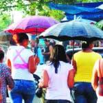 Lluvias. Lluvia. Aguaceros. Sombrilla. El Nacional/ Jorge Gonzalez. 10.07.2009