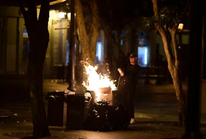 2. A demonstrator burns trash on the street during clashes in San Juan, Puerto Rico, Monday, July 22, 2019.  Protesters are demanding Gov. Ricardo Rossello step down following the leak of an offensive, obscenity-laden online chat between him and his advisers that triggered the crisis.  (AP Photo / Carlos Giusti)