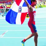Dominican Republic's Luguelin Santos celebrates winning bronze in the men's 400-meter final at the World Athletics Championships in the Luzhniki stadium in Moscow, Russia, Tuesday, Aug. 13, 2013. (AP Photo/Ivan Sekretarev)