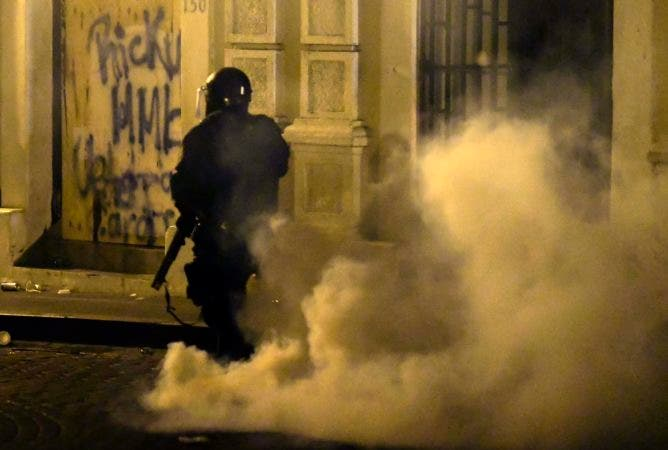 3. A member of the riot control units patrol the street during clashes in San Juan, Puerto Rico, Monday, July 22, 2019.  Protesters are demanding Gov. Ricardo Rossello step down following the leak of an offensive, obscenity-laden online chat between him and his advisers that triggered the crisis.    (AP Photo /Carlos Giusti)