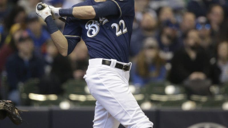 Milwaukee Brewers' Christian Yelich watches his home run against the St. Louis Cardinals during the first inning of a baseball game Sunday, March 31, 2019, in Milwaukee. (AP Photo/Jeffrey Phelps)