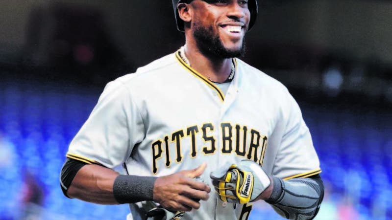 Pittsburgh Pirates' Starling Marte smiles after drawing a walk during the first inning of the team's baseball game against the Miami Marlins, Friday, April 13, 2018, in Miami. (AP Photo/Lynne Sladky)