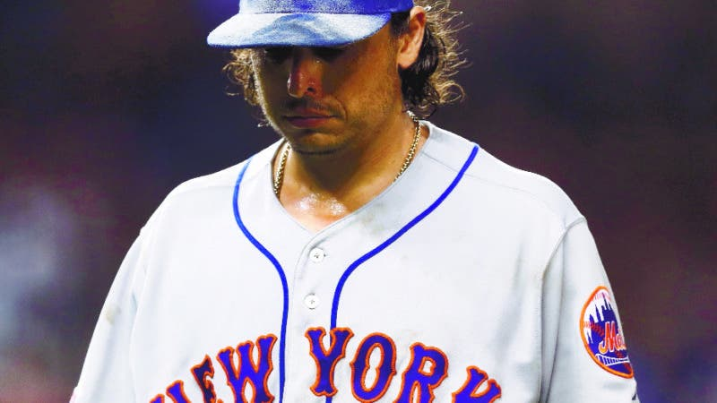 New York Mets starting pitcher Jason Vargas walks off the field after being taken out of the baseball game game during the sixth inning against the Miami Marlins on Friday, July 12, 2019, in Miami. (AP Photo/Brynn Anderson)