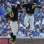 Pittsburgh Pirates' Starling Marte, right, celebrates with Josh Bell, left, after hitting three-run home run against the Chicago Cubs during the eight inning of a baseball game, Friday, July 12, 2019, in Chicago. (AP Photo/Kamil Krzaczynski)