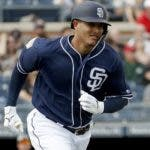San Diego Padres' Manny Machado runs out a ground out against the San Francisco Giants during the first inning of a spring training baseball game, Saturday, March 2, 2019, in Peoria, Ariz. (AP Photo/Matt York)