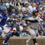San Diego Padres' Francisco Mejia, right, watches his solo home run during the seventh inning of a baseball game against the Chicago Cubs in Chicago, Sunday, July 21, 2019. (AP Photo/Nam Y. Huh)