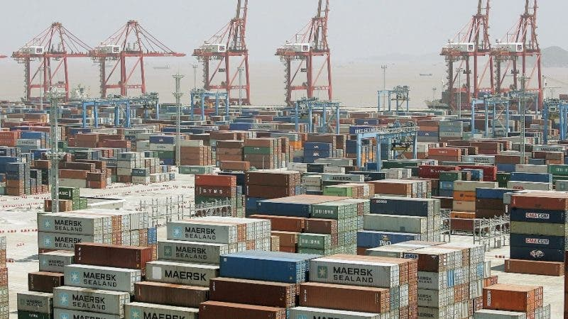 ** FILE ** In this June 9, 2005 file photo, containers are piled up at Ningbo Port in Ningbo, China. China's June global trade surplus fell 20 percent from the same month last year as export growth slowed amid weaker global demand but the surplus with the United States and Europe grew, according to data reported Thursday, July 10, 2008. (AP Photo/Eugene Hoshiko, FILE)